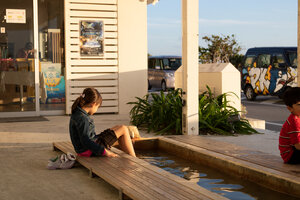 Our daughter using the free outdoor ashiyu (foot bath) at Umikaji Terrace