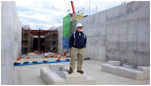 Rob Oechsle standing in the Yui Rail tunnel during its earlier construction phase.