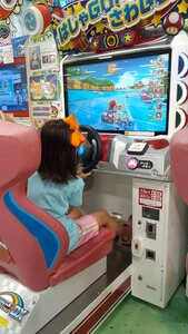 Mario Kart racing at the arcade
