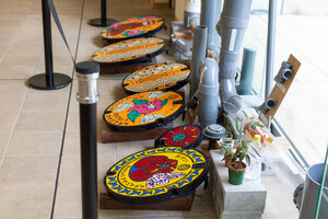 A few manhole covers on display at Naha City's Water and Sewer Department
