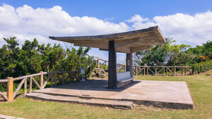 A covered bench to get out of the high noon sun at Hacksaw Ridge
