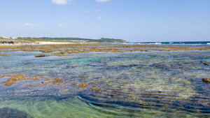 Towards the sea in the deeper tide-pools looking back on the beach of Yamashiro Coast