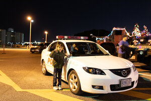 Posing by a USMC PMO car at the Camp Kinser Tree Lighting Ceremony