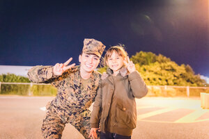 Daughter with excellent Marine at Camp Kinser Tree Lighting Ceremony