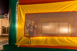 Daughter all to herself in bounce house at the end of Camp Kinser Tree Lighting Ceremony
