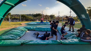 Locals, and bigger kids/teens, having fun on the trampolines at Inochi-no-tamago Park