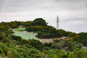 A barren hillside where the haunted hotel in Okinawa used to sit
