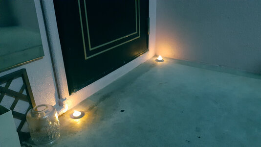 Candles placed outside of a door in Okinawa for Obon