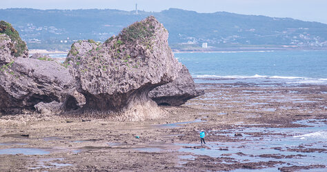 Rock Formation and Fisherman